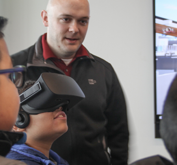 Boys & Girls Club students visit EUA and test out virtual reality slide