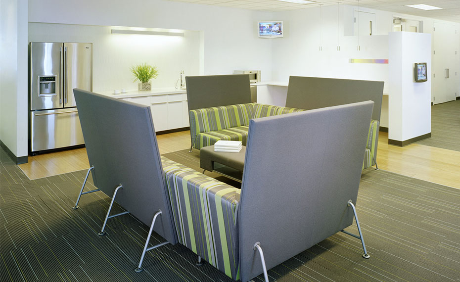 Break room seating couches with high backs for privacy.